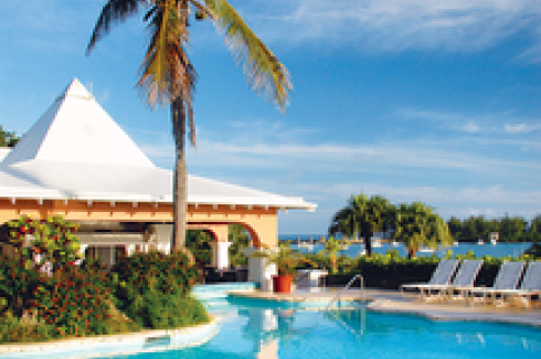 A view of the pool and beyond at Grotto Bay Beach Resort